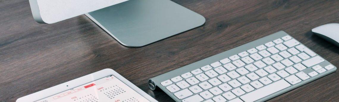 productivity mac setup with thunderbold monitor, ipad air tablet, mac keyboard, mac mouse