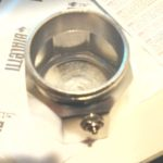 top view of silver moka pot chamber and pressure valve