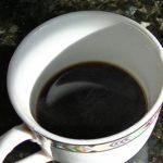 moka pot coffee in a small cup like espresso black like tar