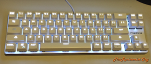 68 Keys Mini Magicforce mechanical keyboard full view on desk in artificial light