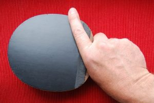 table tennis shakehand grip with finger to the side