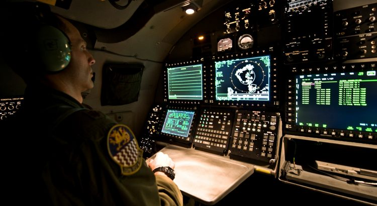 battle ship station with lots of buttons, multiple screens, graphs