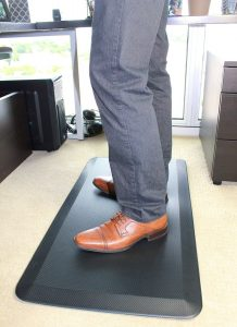 standing on a anti fatigue mat for better standing posture