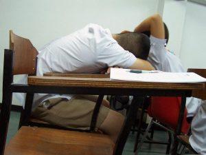 slouching over desk sleeping